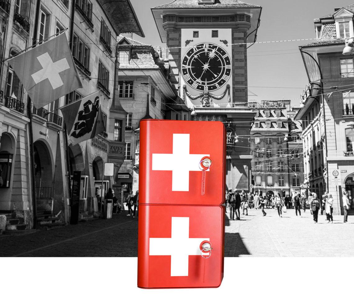 Borne de recharge pour téléphones rouge avec sticker blanc suisse